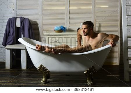 Sex And Relaxation Concept: Macho Sitting Naked In Bathtub