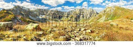 Beautiful Autumn Mountain Landscape Panorama. Panoramic View Of Mountain Peaks