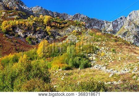 Beautiful Autumn Mountain Landscape. Panoramic View Of Mountain Peaks