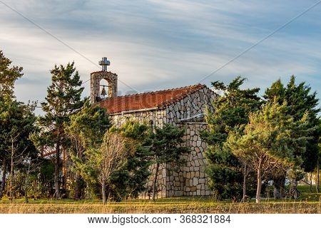 The Beautiful Orthodox Church Of Arogi Built Near Lake Karatza With Its Pine Tree Forest Back Yard.