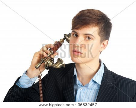 young man talking on retro phone