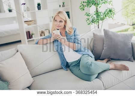 Photo Of Attractive Aged Mature Homey Domestic Lady Sitting Comfy Sofa Couch Drink Coffee Peaceful G