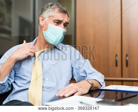 People wearing a surgical mask suffering for hot climate