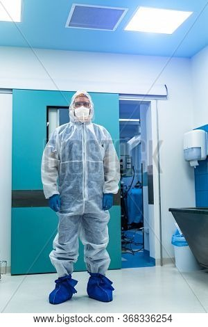 Doctor In Protective Ppe Suit. Intensive Care Unit