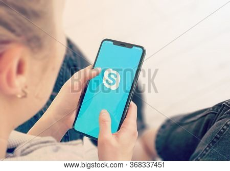 Kyiv, Ukraine-january, 2020: Skype On Cellphone Screen. Young Girl Pointing Or Texting Skype On Smar