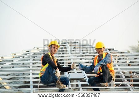 Builder Working On Roof Of New House,roofer Builder Working On Roof Structure Of Building On Constru