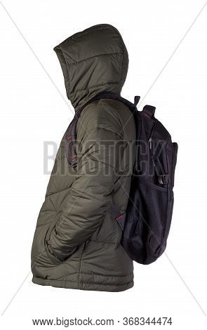 Black Backpack Dressed In A Hakki Jacket Isolated On A White Background. Rear View Of A Backpack And