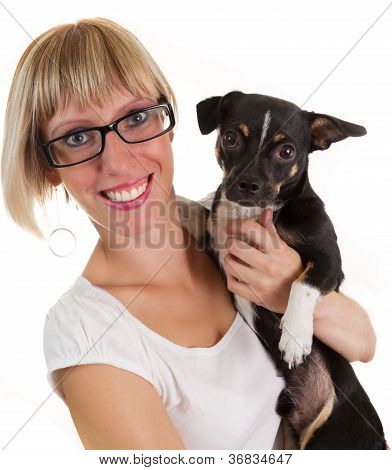 Portrait Of Young Woman And Small Cute Dog