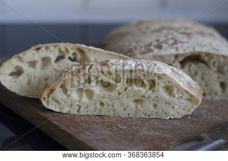 Italian Ciabatta Bread Sliced On A Board