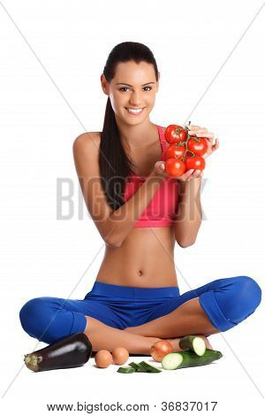 Brunette Lady Sitting On The Floor With Vegetables