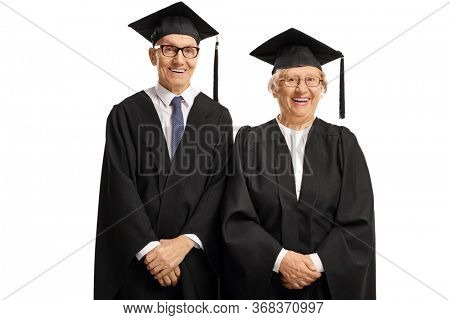 Elderly man and woman wearing a graduation gown and smiling isolated on white background