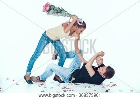Jealous Woman Fight Adulterous Boyfriend With Flowers. Photo Isolated On White Background. Mistrust
