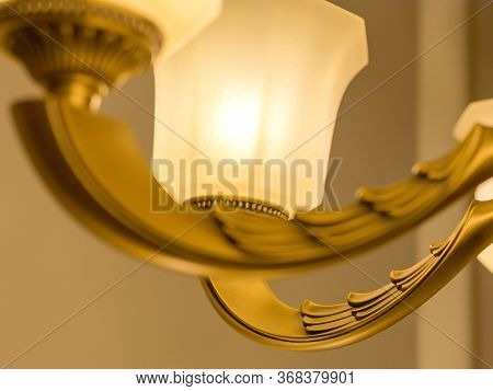 Close up on crystal of classic decor chandelier, is a branched ornamental light fixture designed to