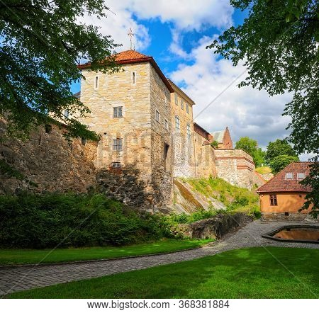 Scenic View Of Medieval Castle Akershus Fortress In Oslo, Norway. Akershus Fortress Is One Of The Po