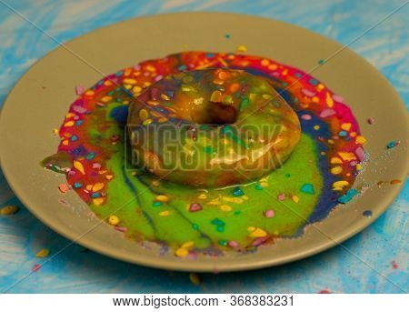 Colorful Donuts With Many Colored Shavings On A Plate With Colored Caramel