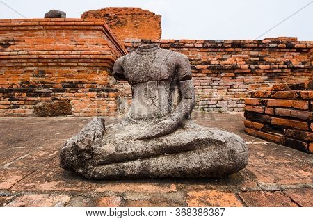 Headless Stone Sculpture Of A Sitting Buddha From The Main Shrine In Ayutthaya, Thailand