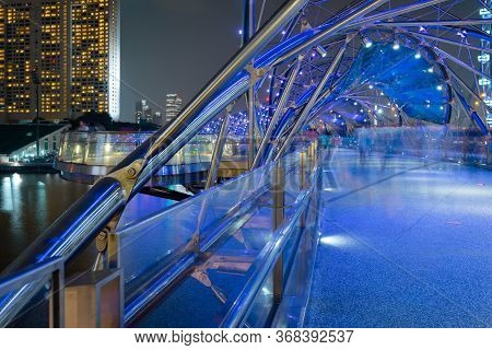 Singapore - 20 Oct 2015: Perspective View Of The Helix Footbridge Over Marina Bay, At Night, In Down