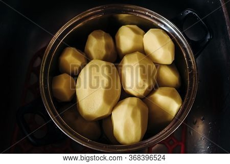 Large Peeled Potatoes In A Silver Pot. Clean Potatoes For Cooking. Dishes With Peeled Potatoes.the V