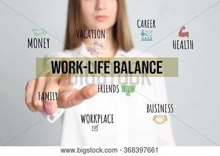 Woman Pointing On Phrase Work-life Balance Against Light Background, Closeup