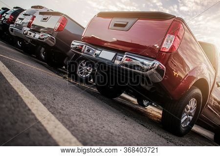 Line Of Parked Modern Cars. Pickup Trucks And Suv Sport Utility Vehicles From Creative Ground Level