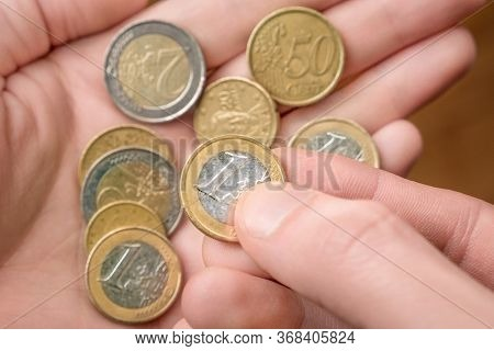 Coins In Hand. Hands Counting A Few Euro Coins. A Hand Of Coins In The Palm. Economic Crisis. Coins