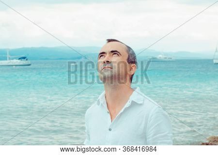 Man Enjoying Nature, Daydreaming Smiling Looking Up Isolated Seascape Outdoor Background. Enjoy Vaca