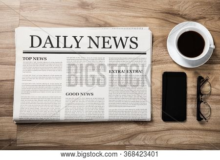 Newspaper With The Headline News And Glasses And Coffee Cup On Wooden Table, Daily Newspaper Mock-up