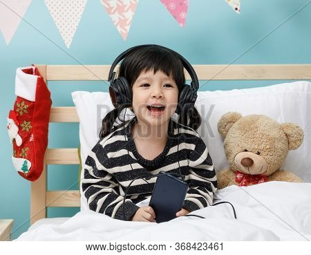 Cute Little Girl Singing With Smartphone With Teddy Bear In Her Bedroom, Happy Asian Child Little Gi