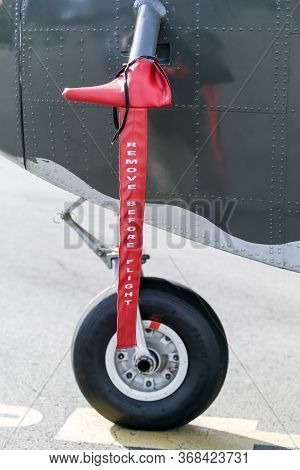 Remove Before Flight Tag Sign Attached To An Aircraft. Warning Label For Airplane Work Installed At