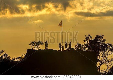Silhouette Of Sunset And Light Flare At The Mountain Named Pha Chu Thong At Phu Hin Rong Kla Nationa