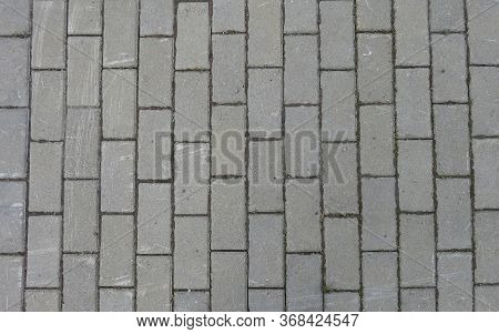 grey paving tiles for the sidewalk around the building
