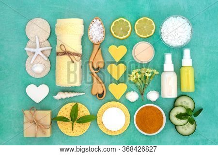 Beauty treatment for restorative skin care with lemon, turmeric powder and cucumber, with spa, moisturising, ex foliation and cleansing products. Anti ageing health care concept.Flat lay.