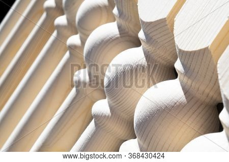 Woodwork. Element Of A Wooden Interior Staircase. Wooden Baluster Close-up View. Handmade Baluster F