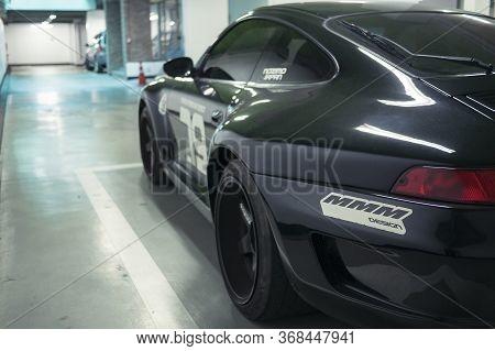 Seoul, South Korea - 03.11.18: Tuning Black Porsche 911 Rear View. Black Classic Porsche 911 Stands