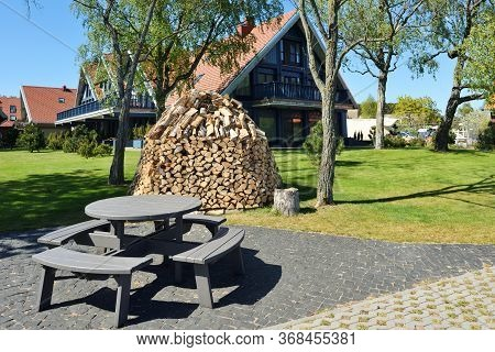 Preparation Of Firewood For The Winter. Firewood Background, Stacks Of Firewood At The Home. Pile Of