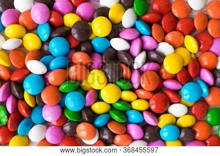 Background Of Multicolored Chocolate Jelly Beans, Multicolored Sweets Base For Background