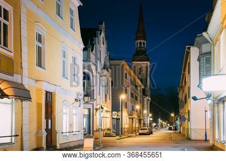 Parnu, Estonia. Night View Of Nikolai Street With Old Houses, Restaurants, Cafe, Hotels And Shops In