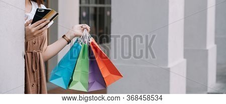 Closeup Of Woman Holding Shopping Colourful Of Shopping Bags On The Street With Copy Space - Shoppin