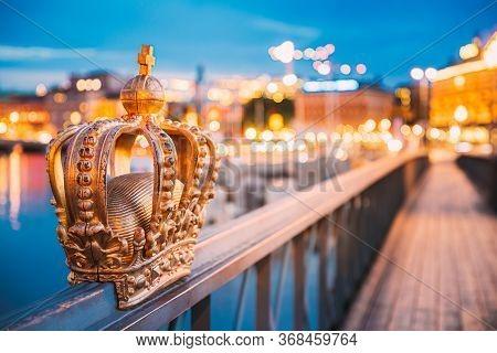 Stockholm, Sweden. Skeppsholmsbron - Skeppsholm Bridge With Its Famous Golden Crown In Night Lights.
