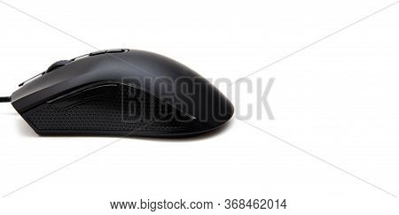 Black Gaming Mouse With Side Extra Keys And A Matte Finish On White Background. Mouse Side View In M