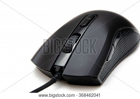 Black Gaming Mouse With Side Extra Keys And A Matte Finish On White Background. Mouse Front View But