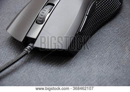 Black Gaming Mouse With Side Extra Keys And A Matte Finish On A Black Background. A Mouse From Diffe