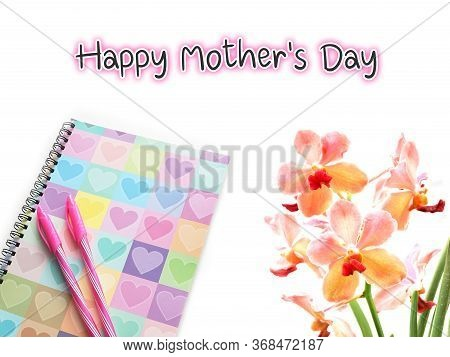 Happy Mother's Day Text On White Background With Colorful Diary And Pink Orchid.