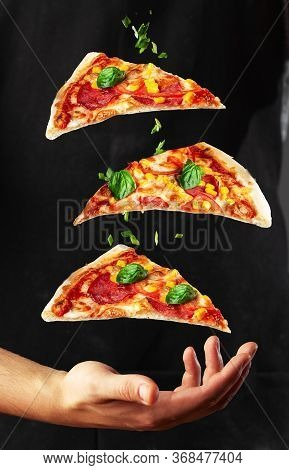 People Hand Taking Three Slices Of Pizza . Pizza And Food Concept. Close Up Focus On Middle Pizza. O