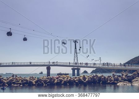 Busan, South Korea, September 14, 2019: View From Below On Moving Songdo Cable Cars And Overwater Wa