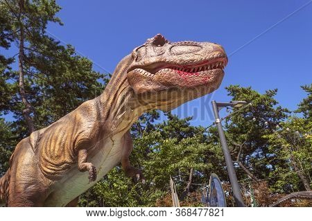 Busan, South Korea, September 14, 2019: Sculture Of Tyrannosaurus In Amnam Park On Sunny Day