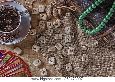 Isoteric Concept Of Divination And Prediction. Tarot Cards, Runes, Coffee Grounds In A Cup, Rosary O