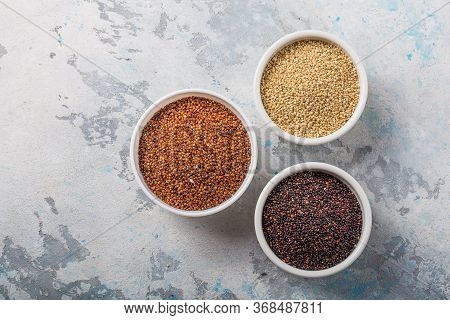 Black, Red And White Quinoa Grains In A Wooden Spoon On White Background. Gluten Free Healthy Food.
