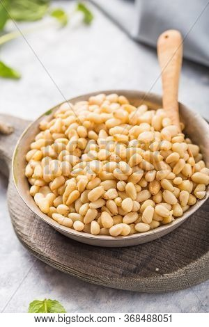 Shelled Raw Pine Nuts In  Bowl On Concrete  Background. Superfood, Vegan, Vegetarian Food Concept.sh
