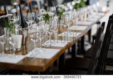 Tables Setting At A Luxury Wedding. Table For Guests. Dishes And Drinks. Floral Decorating, White Ch